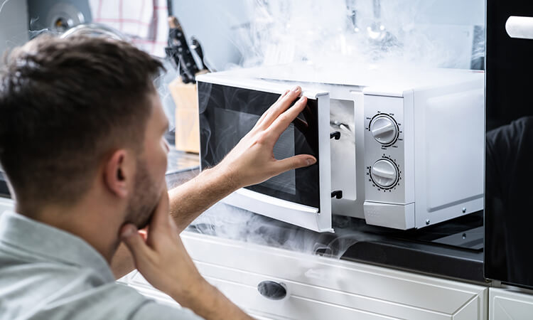 How To Get Burnt Popcorn Smell Out Of The Microwave